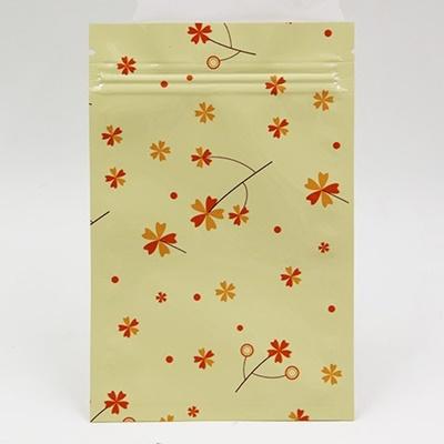 ซองซิปลายดอกไม้สีส้มแดงพื้นหลังสีครีม 100 ชิ้น (คลิกเพื่อเลือกขนาด)
