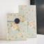 ซองกระดาษขยายข้างสีฟ้าลายดอกไม้สีขาว 13x23+7.8 cm. 90 ชิ้น : Z004776